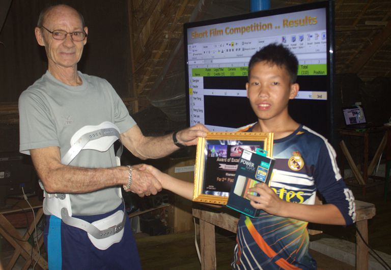 Khamson receives his Certificate and A Power Bank USB Charger