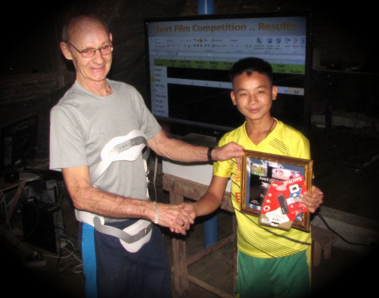 Phaher receives his Certificate and Memory card Reader + 32GB memory card