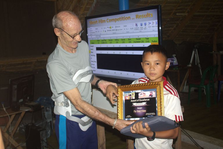 Sangtor receives his Certificate and Note Book Computer